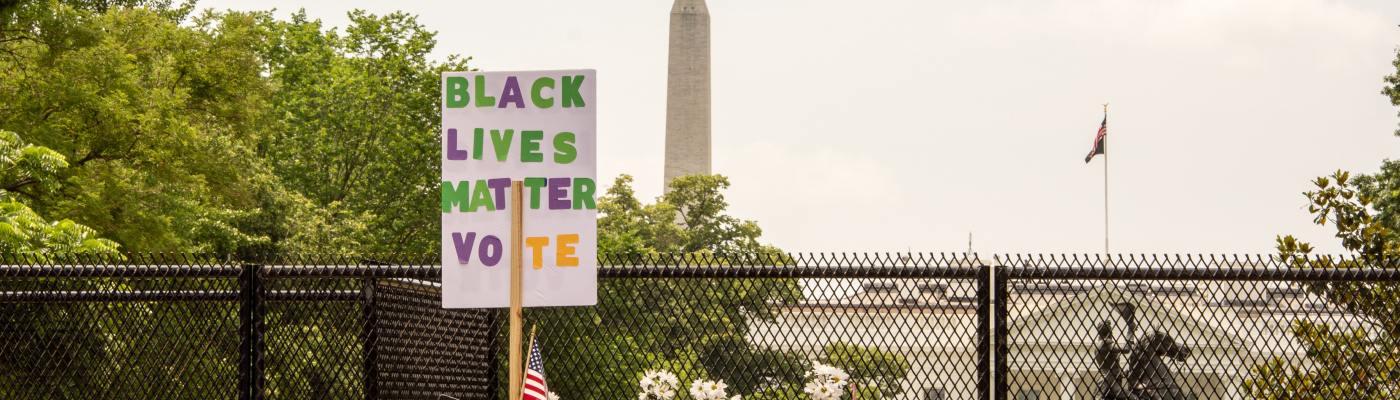 """Header Photo: """"Black Lives Matter. Vote"""" Sign at Protest"""